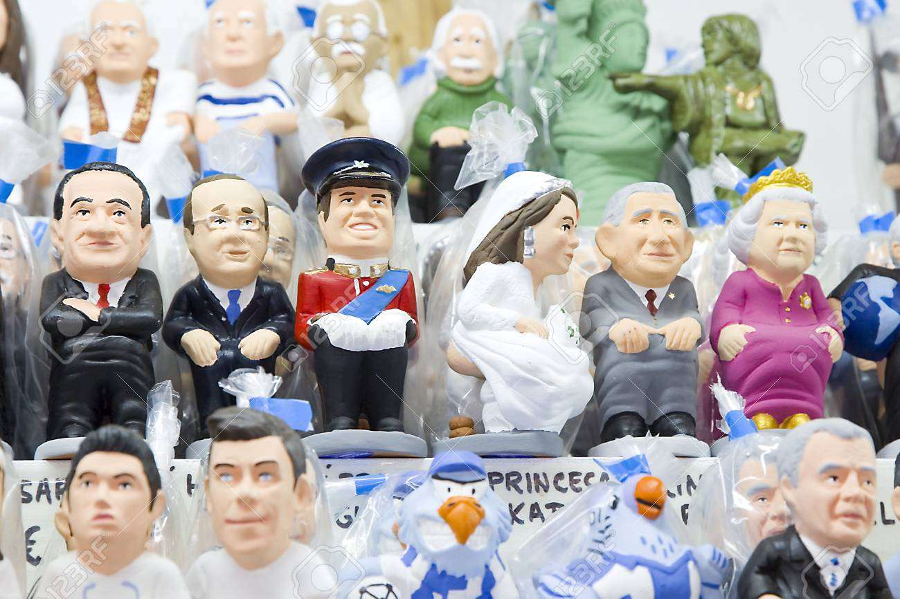 Caganers, originally a character in Catalan mythology, now portraying famous celebrities or characters on sale at Santa Llucia Fair, on December 1, 2013, in Barcelona, Spain Stock Photo - 24375307