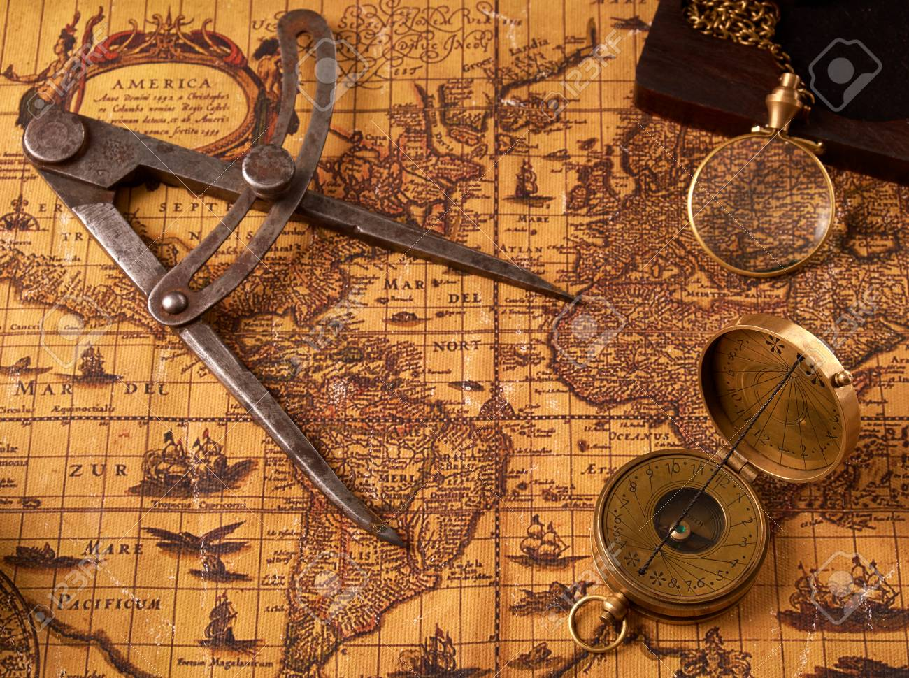 Old vintage retro compass on ancient world map vintage still life old vintage retro compass on ancient world map vintage still life travel geography navigation gumiabroncs Image collections