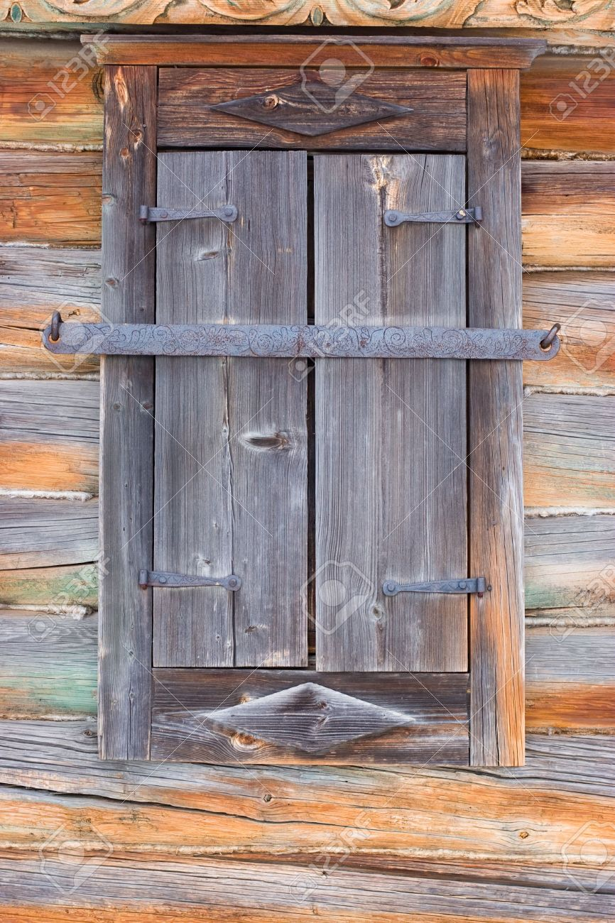 Rustic wooden window closed with shutters Stock Photo - 2572419
