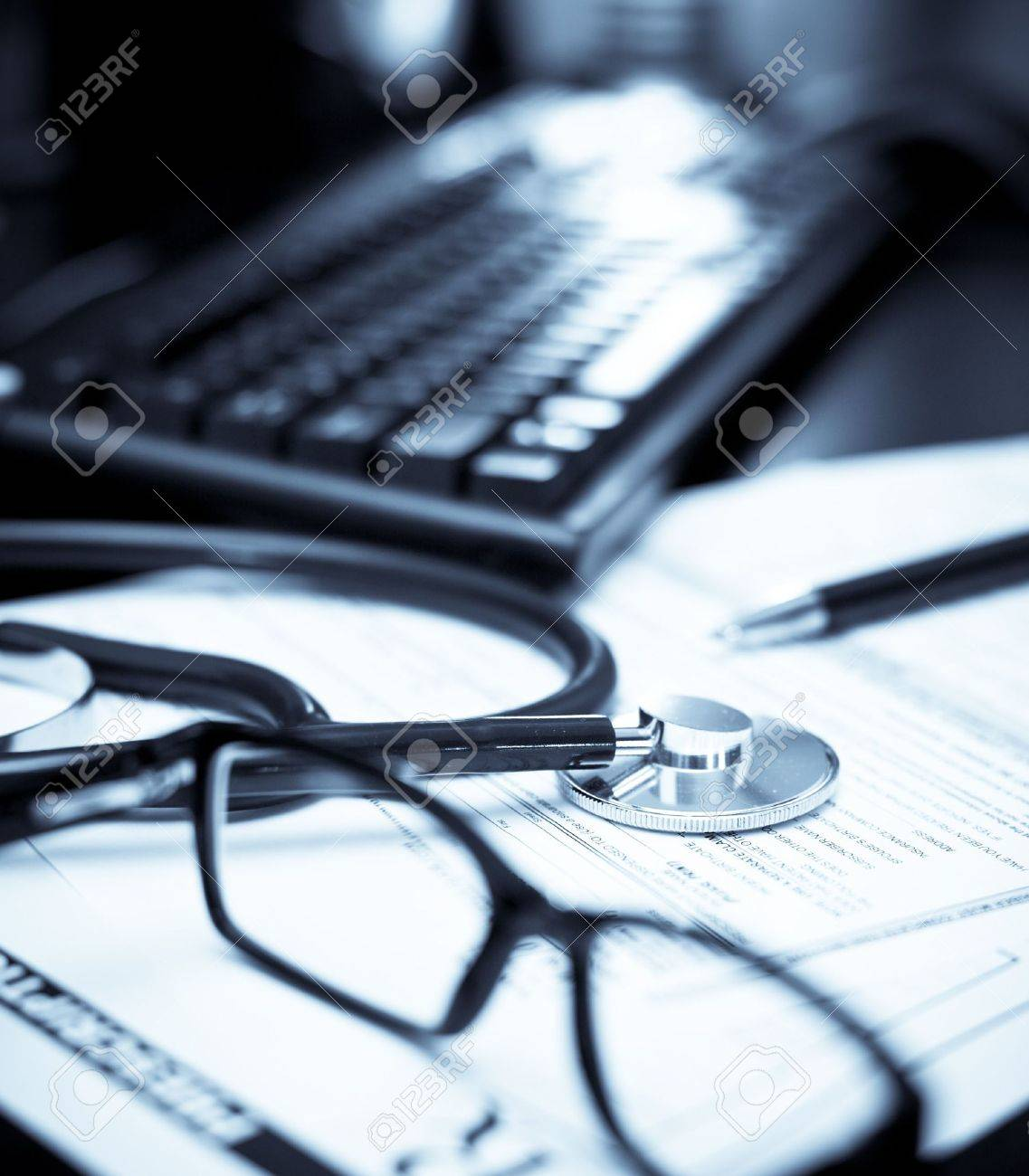 Stethoscope on a prescription form with glasses pen and keyboard, very shallow DOF Stock Photo - 5520953