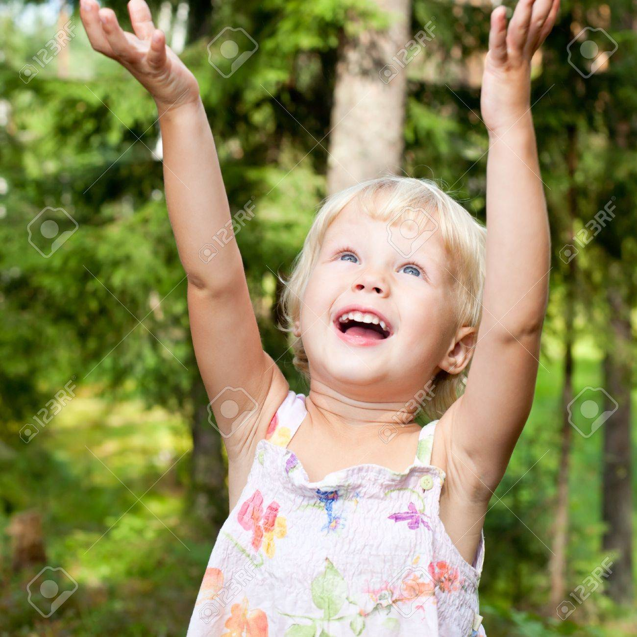 Portrait of cute little girl with hands up in happiness Stock Photo - 7530571