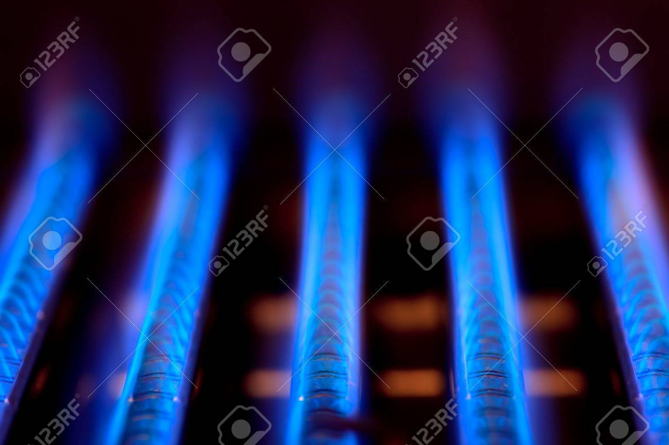 Blue flames of a gas burner inside of a boiler Stock Photo - 8370607