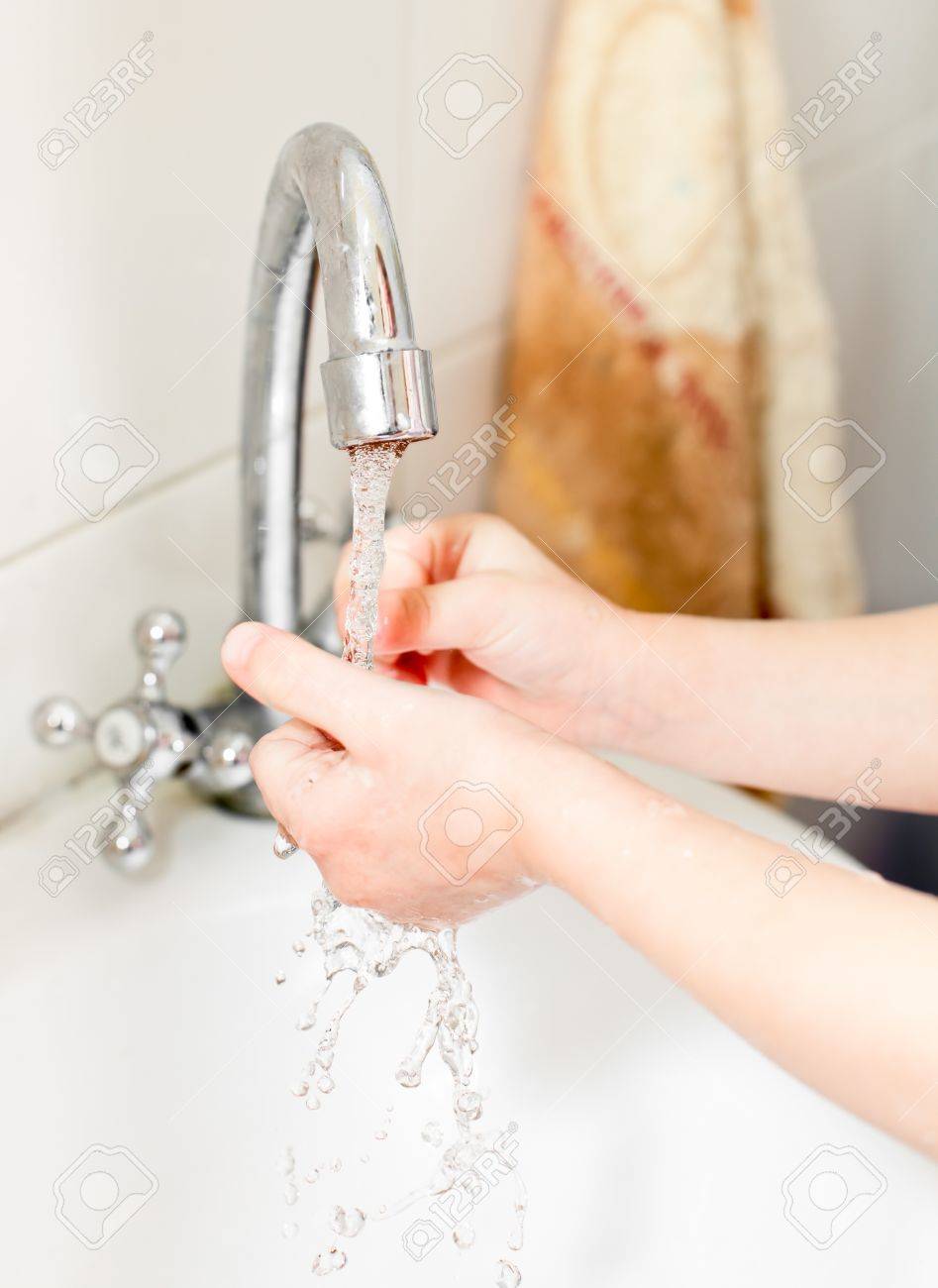 Little girl washing her hands in bathroom, shallow focus Stock Photo - 9373163