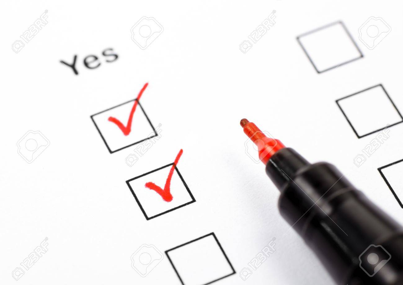 Close up shot of filled check boxes Yes with red pen Stock Photo - 11771505