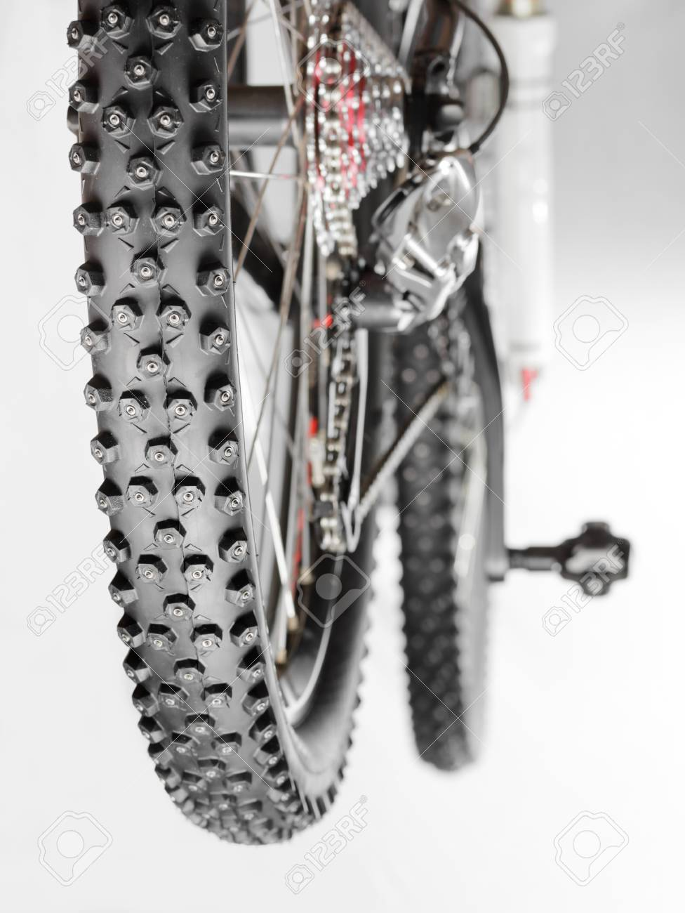 Knobby winter tire with spikes on a mountain bike close-up Stock Photo - 12466554