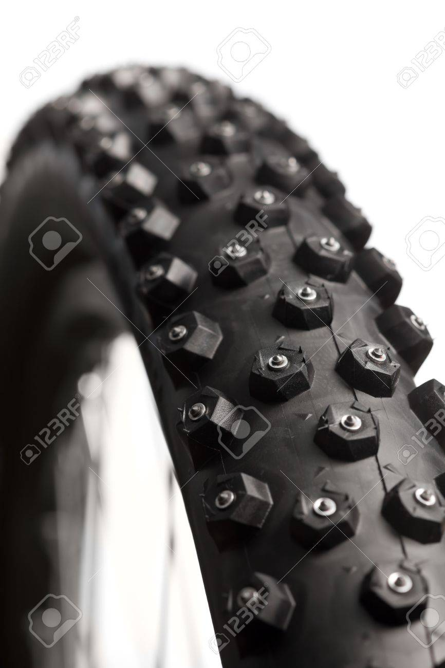 Knobby mountain bike winter tire with spikes  close-up Stock Photo - 21734093