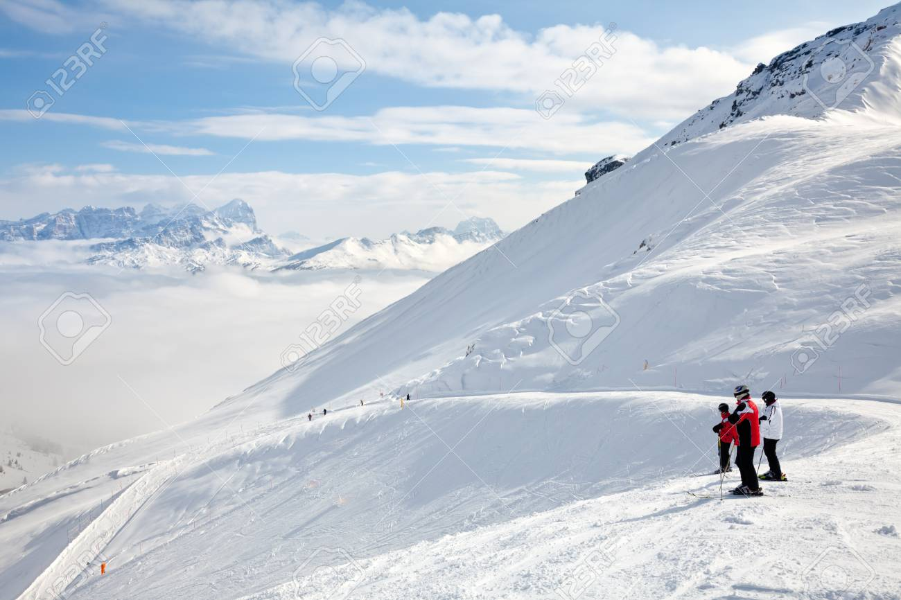 Skiers looking down the slope at Sella Ronda ski route in Italy Stock Photo - 22988667