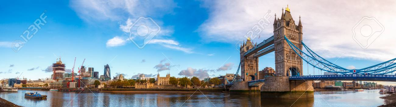Panoramic London skyline with iconic symbol, the Tower Bridge and Her Majesty's Royal Palace and Fortress, known as the Tower of London as viewed from South Bank of the River Thames in the morning light - 92620691