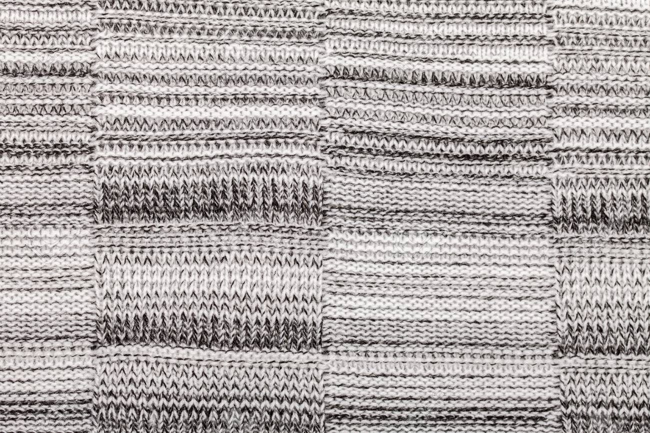 74f7ba14f29482 Grey knitted fabric made of heathered yarn textured background Stock Photo  - 94435329
