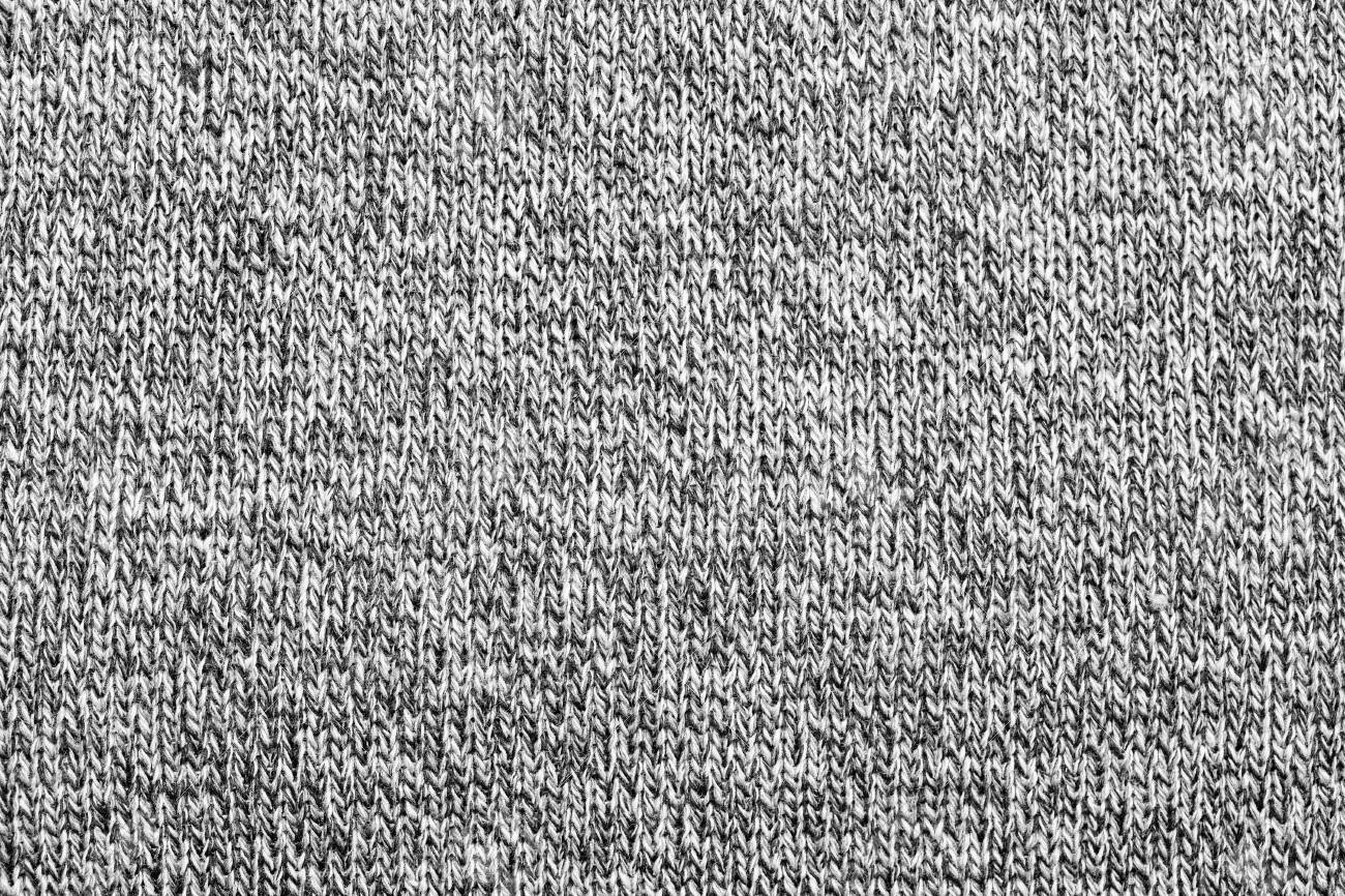 e53a068469d Grey melange knitted fabric made of heather mixed yarn textured background  Stock Photo - 95454020