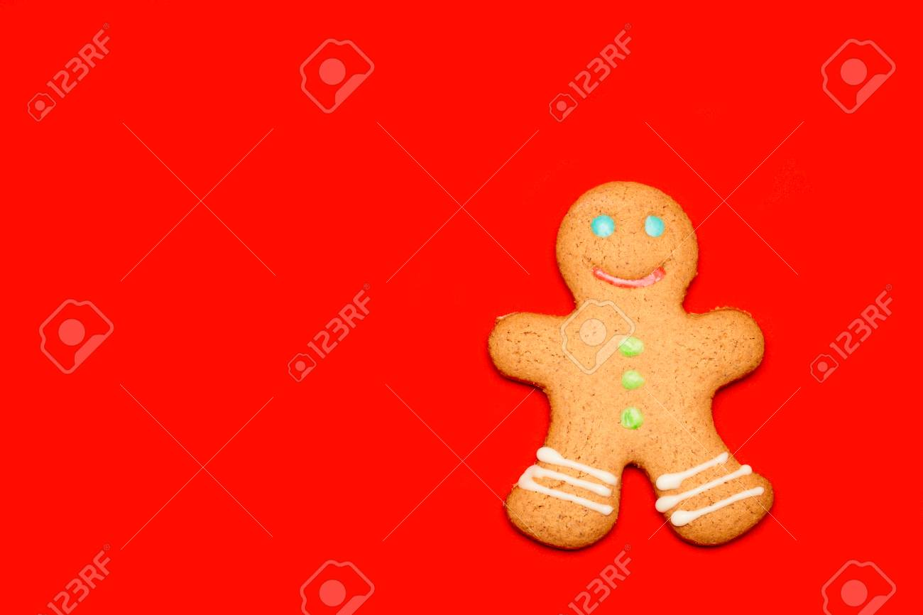 Iced Christmas Gingerbread Man Sugar Cookie On Red Background
