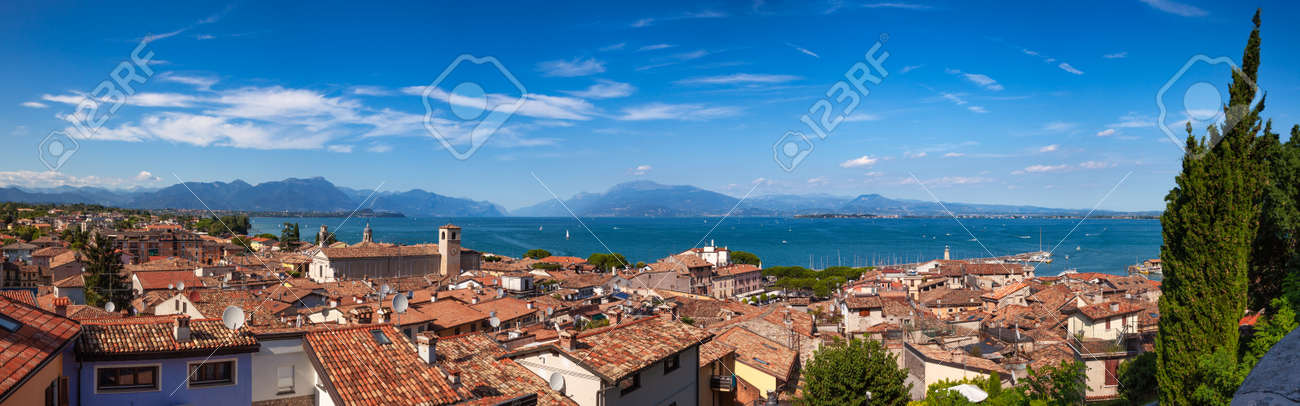 Panoramic view of Desenzano del Garda, a resort town on the southern shore of Lake Garda in Northern Italy. Lake Garda is the largest lake in Italy and a popular holiday location on the edge of the Dolomites - 165058336