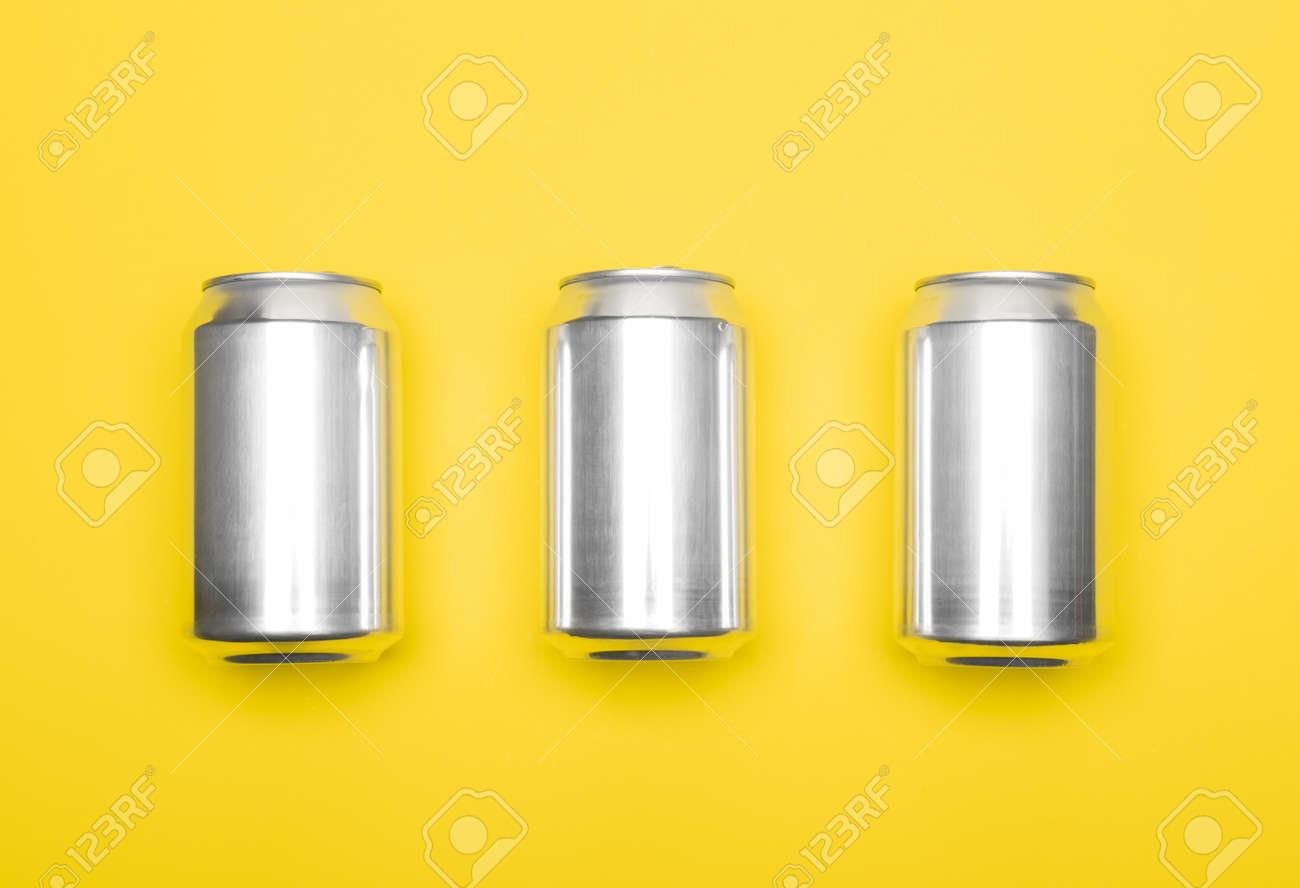 Three 330 ml aluminum beverage drink soda can temlpates on yellow background - 165848644
