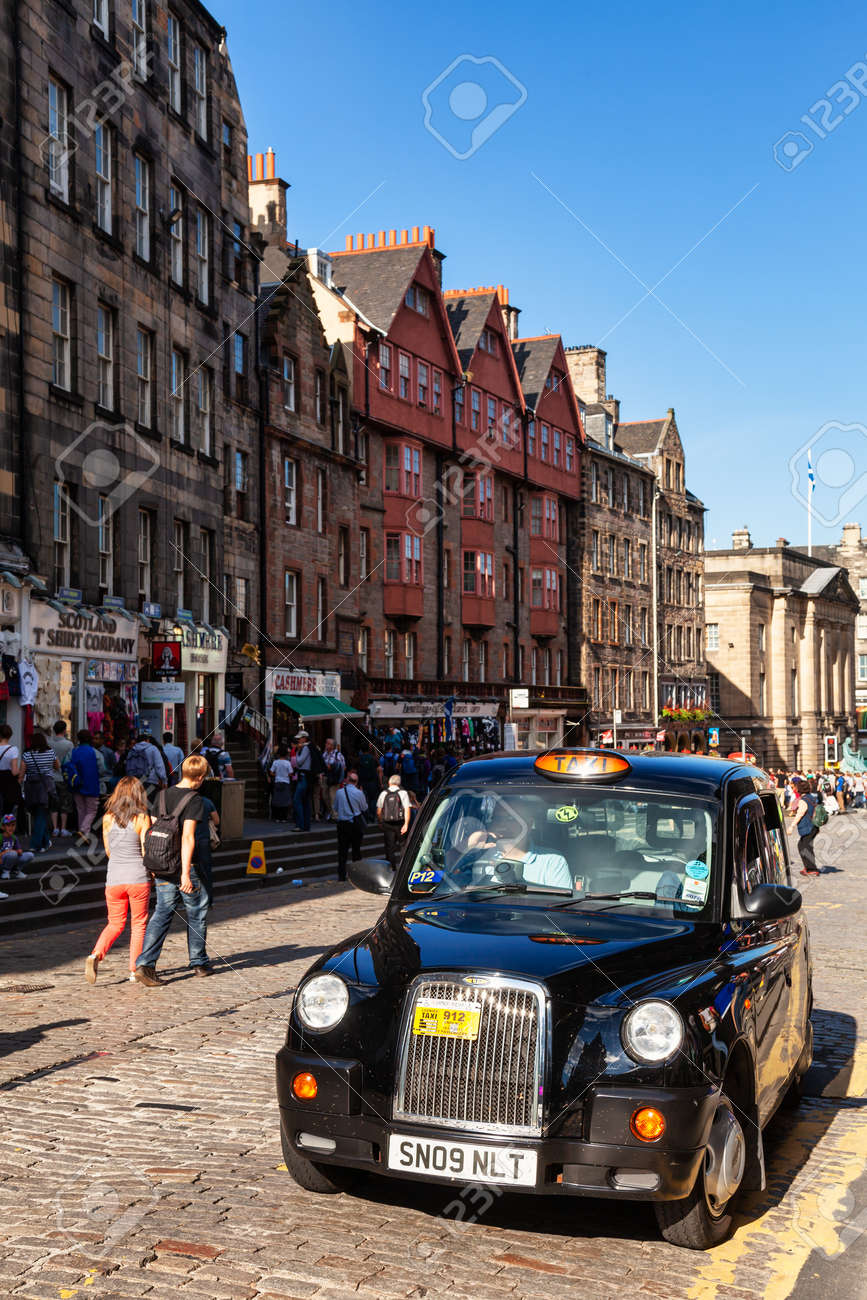 Edinburgh, UK - Aug 9, 2012: Black Cab waiting for client at Royal Mile, a popular tourist attraction and the busiest tourist street in the Old Town - 166775884