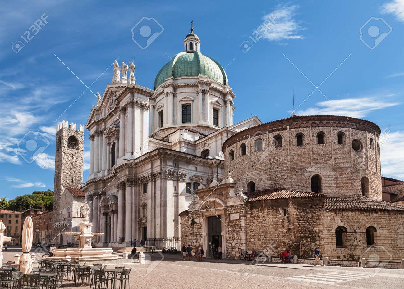 Brescia, Italy - Aug 7, 2016: Piazza Paolo VI with Old Cathedral (Duomo Vecchio) or La Rotonda and New Cathedral (Duomo Nuovo) - 166776716