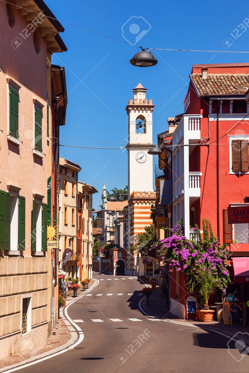 Brenzone sul Garda, Italy - Aug 8, 2016: Winding street of resort town on the eastern shore of Lake Garda, the largest lake in Italy and a popular holiday location on the edge of the Dolomites - 166776717