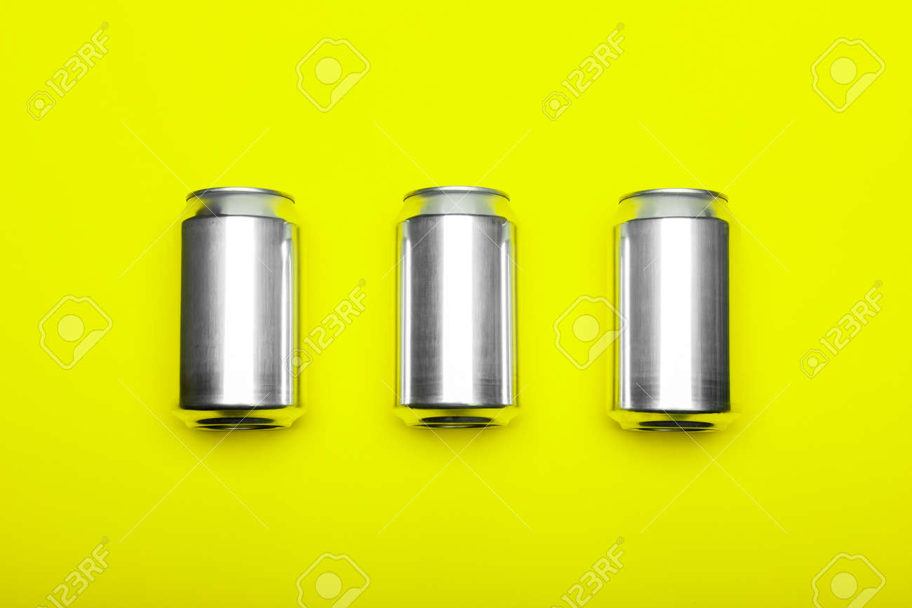 Three 330 ml aluminum beverage drink soda can temlpates on fluorescent yellow-green background - 166560840