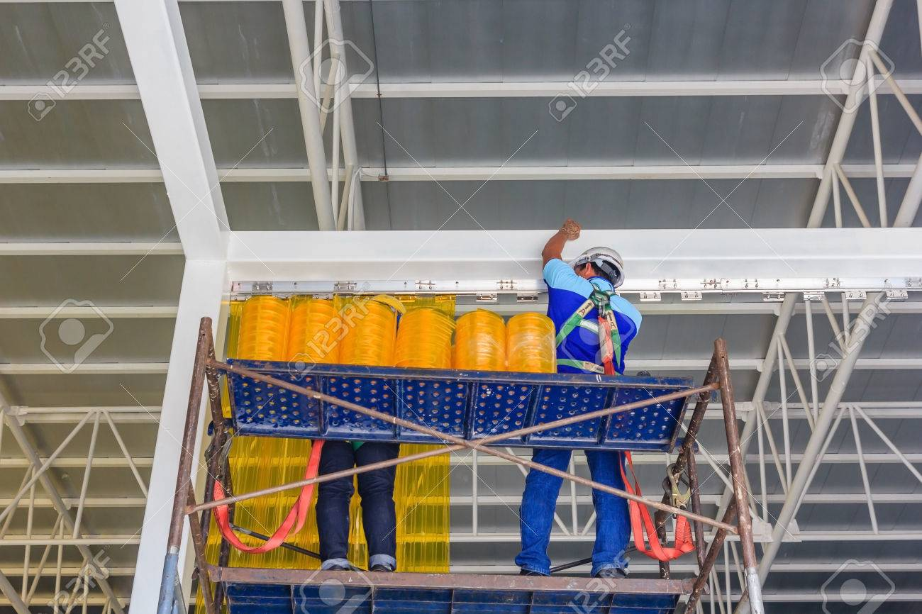 Workers Install PVC Strip Curtain Or Plastic Doors Around
