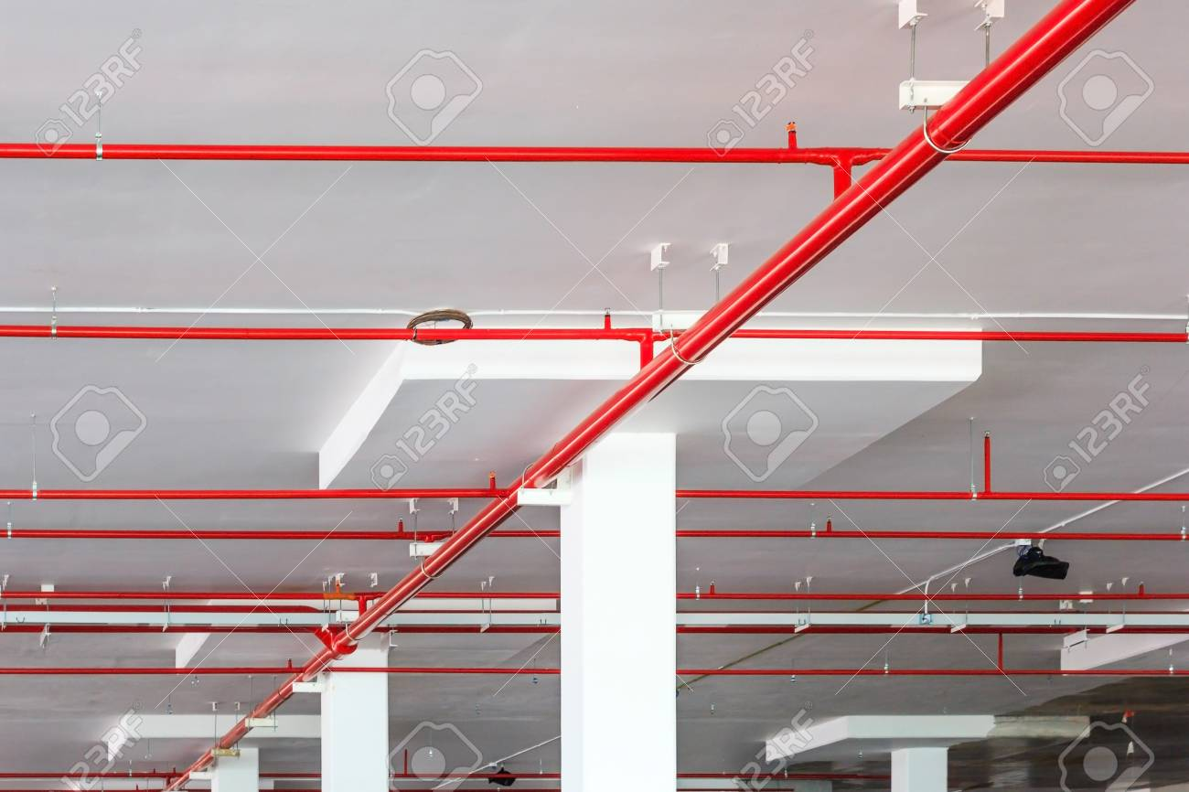 fire sprinkler system with red pipes is placed to hanging from