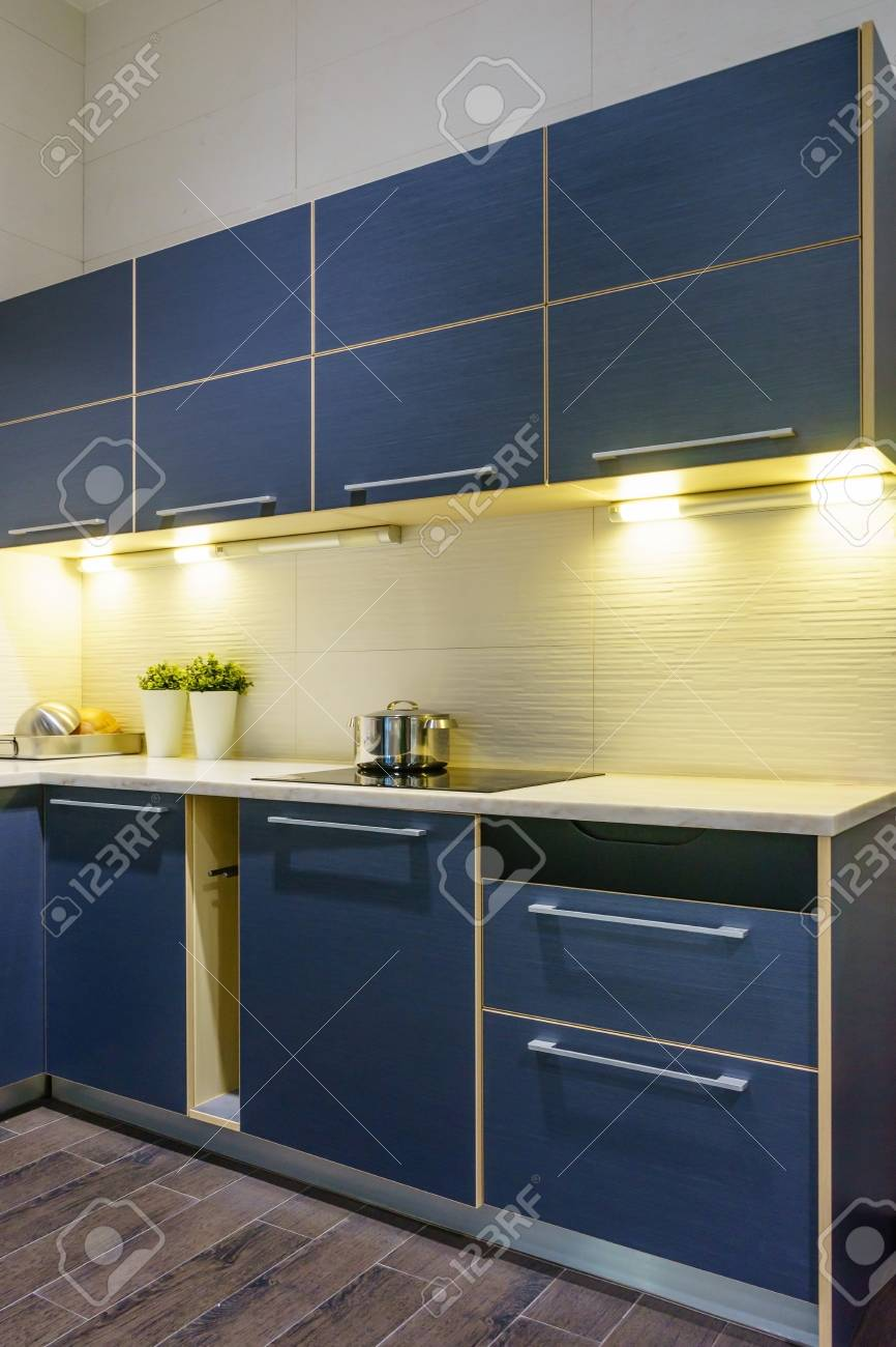 Modern kitchen furniture with contemporary kitchenware like hood,..