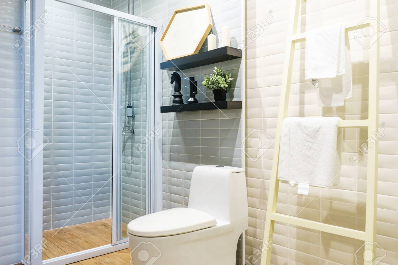 Modern Spacious Bathroom With Bright Tiles With Glass Shower ...