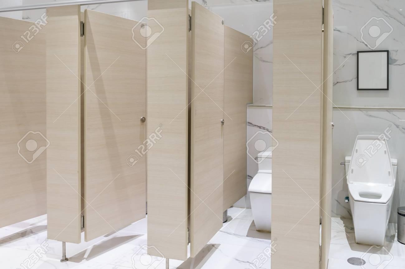 Row Of Urinals Public Toilet, Closeup White Urinals In Bathroom ...