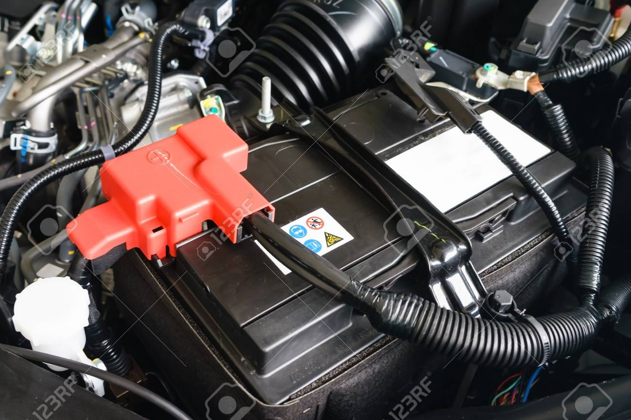 Close Up On New Small Eco Car Battery Installed In The Compartment