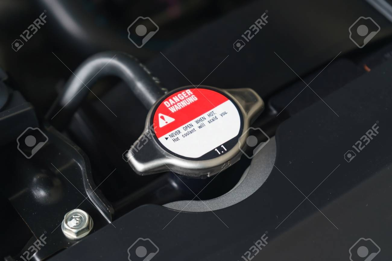 Car Engine Radiator Cap With Warning Label In A Car, Close-up Stock ...
