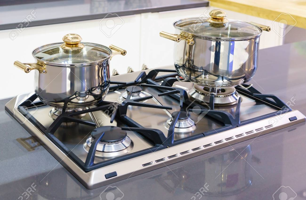 Close-up Of Stainless Steel Cooking Pot On Induction Hob In ...