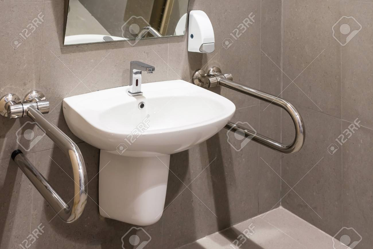 Interior Of Bathroom For The Disabled Or Elderly People. Handrail ...