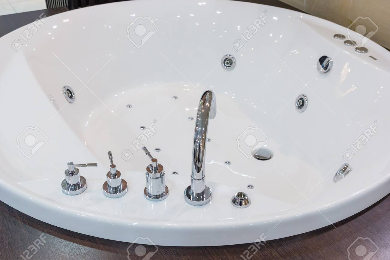 Bathtub Faucet In Modern Bathroom. White Bath Tub With Faucet ...
