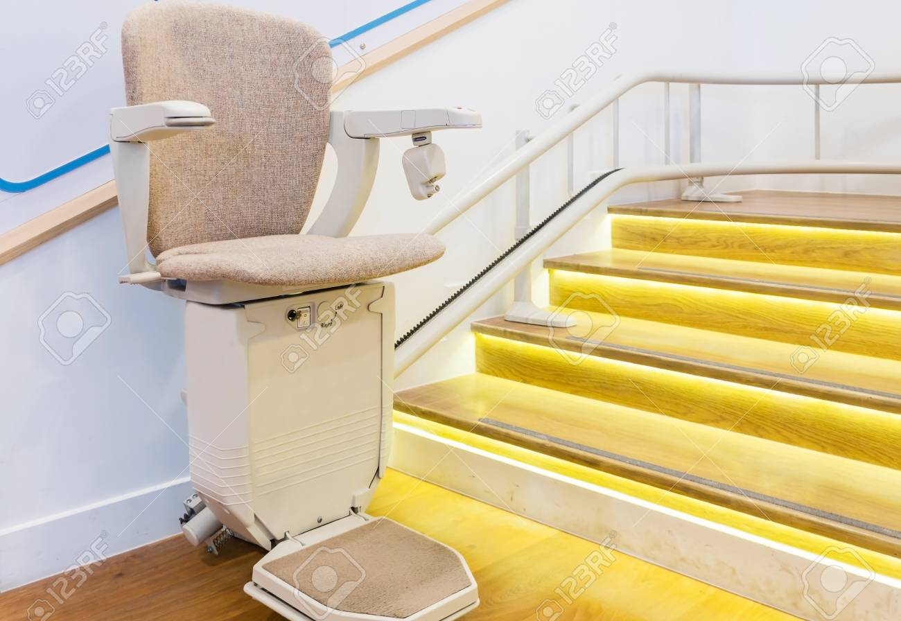 chair lift elderly old age person automatic stair lift on staircase for elderly people and disabled persons stock photo 95043006 stair lift on staircase for elderly people and disabled