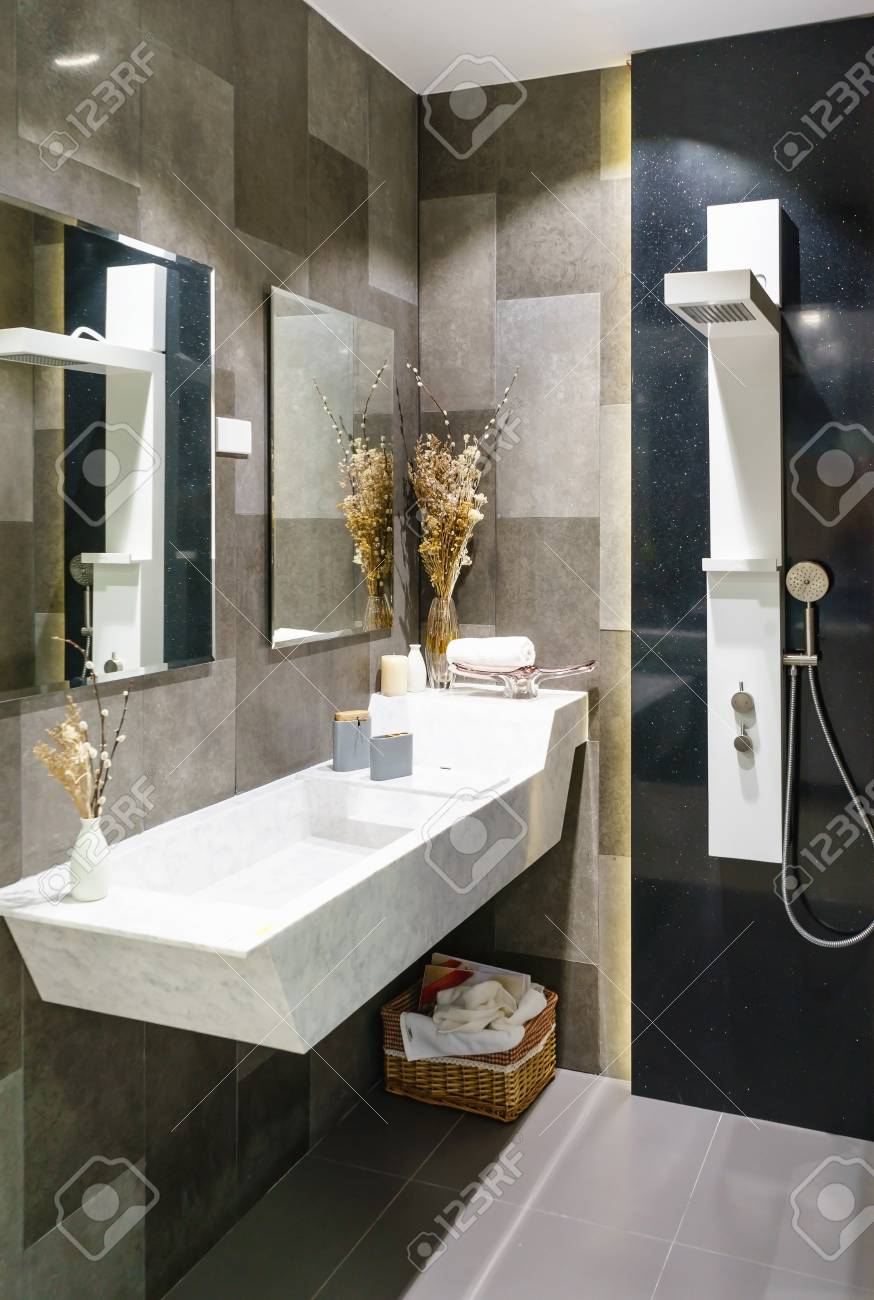 Interiors Shots Of A Modern Bathroom In The Foreground The Shower With  Concrete Floor And Toilet