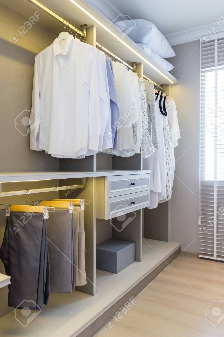 Attirant Modern Wooden Wardrobe With Clothes Hanging On Rail In Walk In Closet  Design Interior Stock Photo
