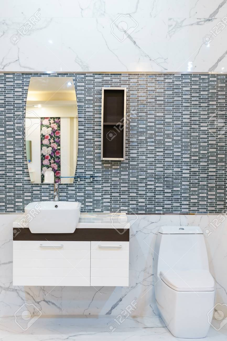 Modern Spacious Bathroom With Bright Tiles With Toilet And Sink ...