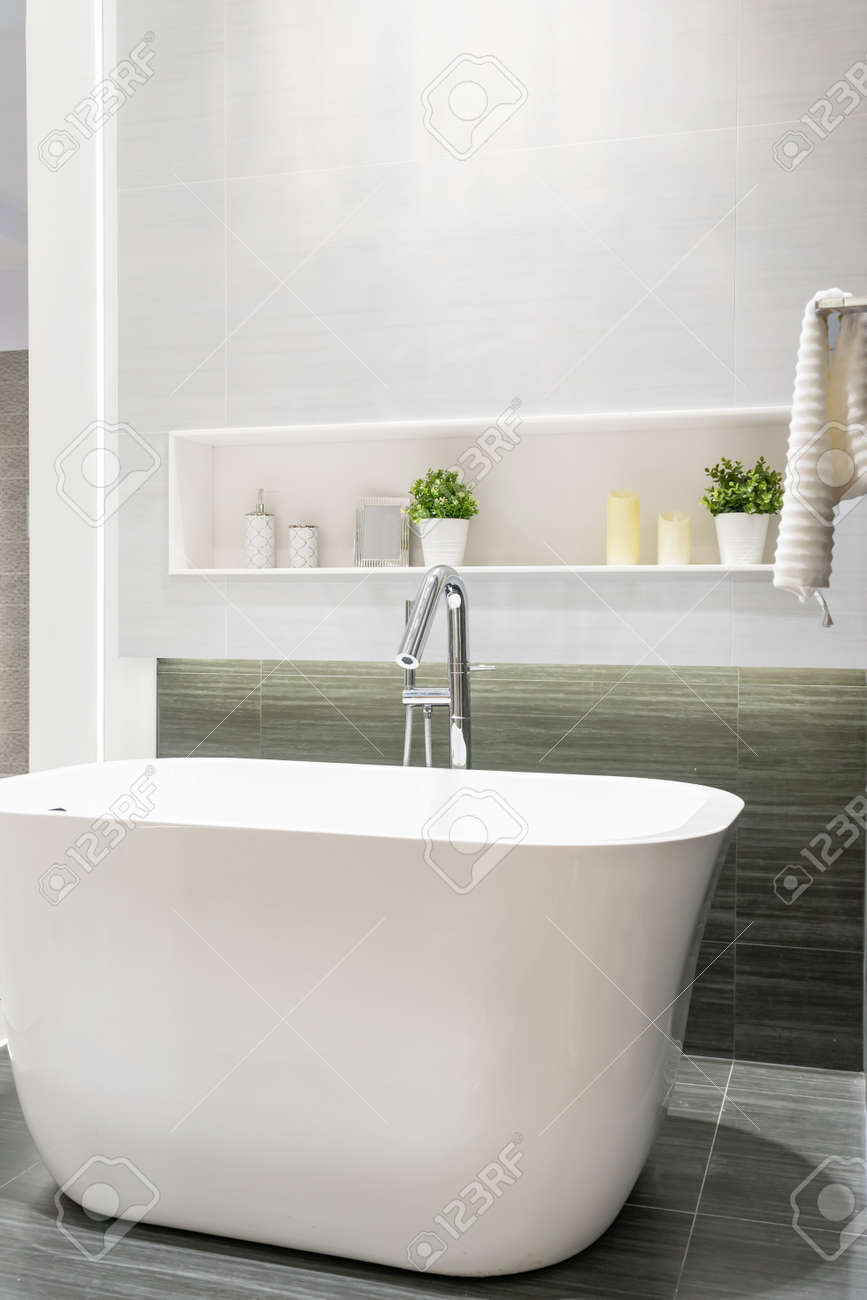 Modern bathroom interior with minimalistic shower and lighting, white toilet, sink and bathtub - 151694715