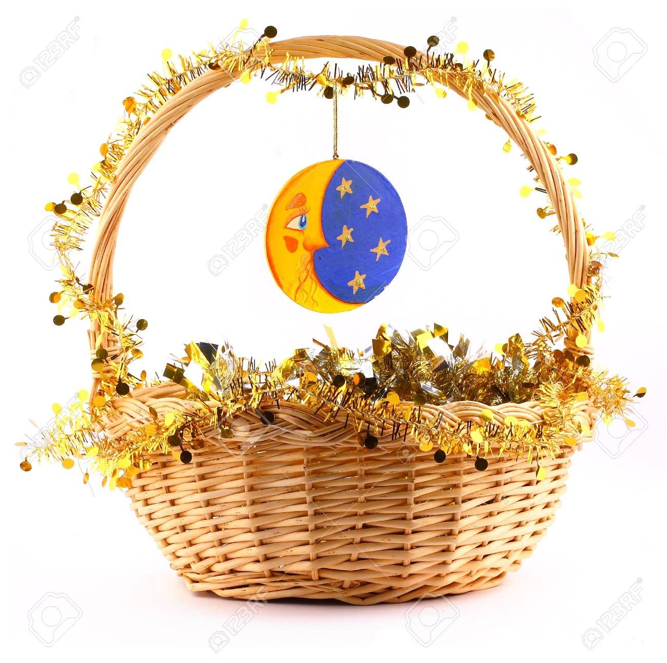 wooden moon attached to string to the present basket witha a gold garland Stock Photo - 2051750