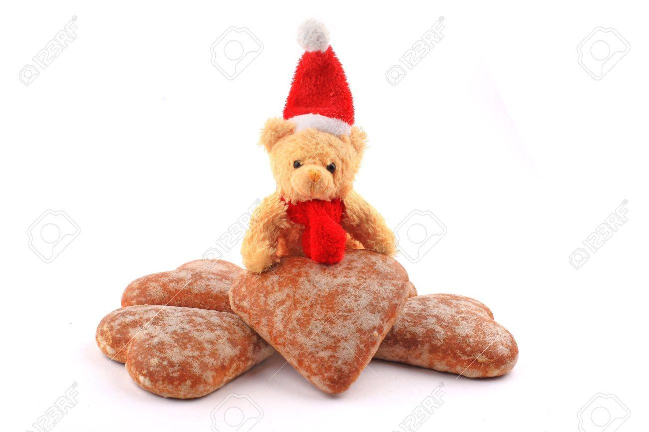 Santa teddy bear on pile of honey-cakes hearts Stock Photo - 2073993