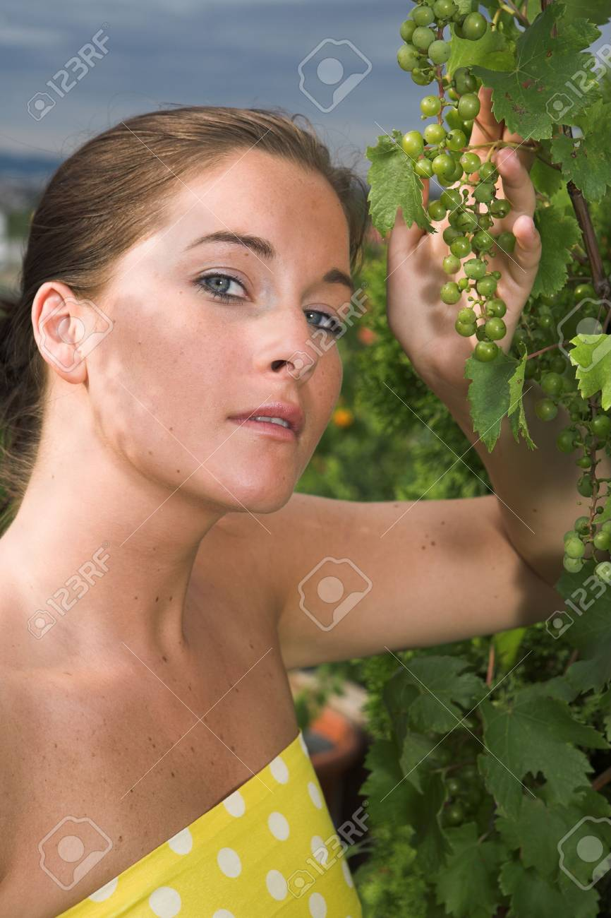 Young attractive Woman with grapes in her hand Stock Photo - 5247257