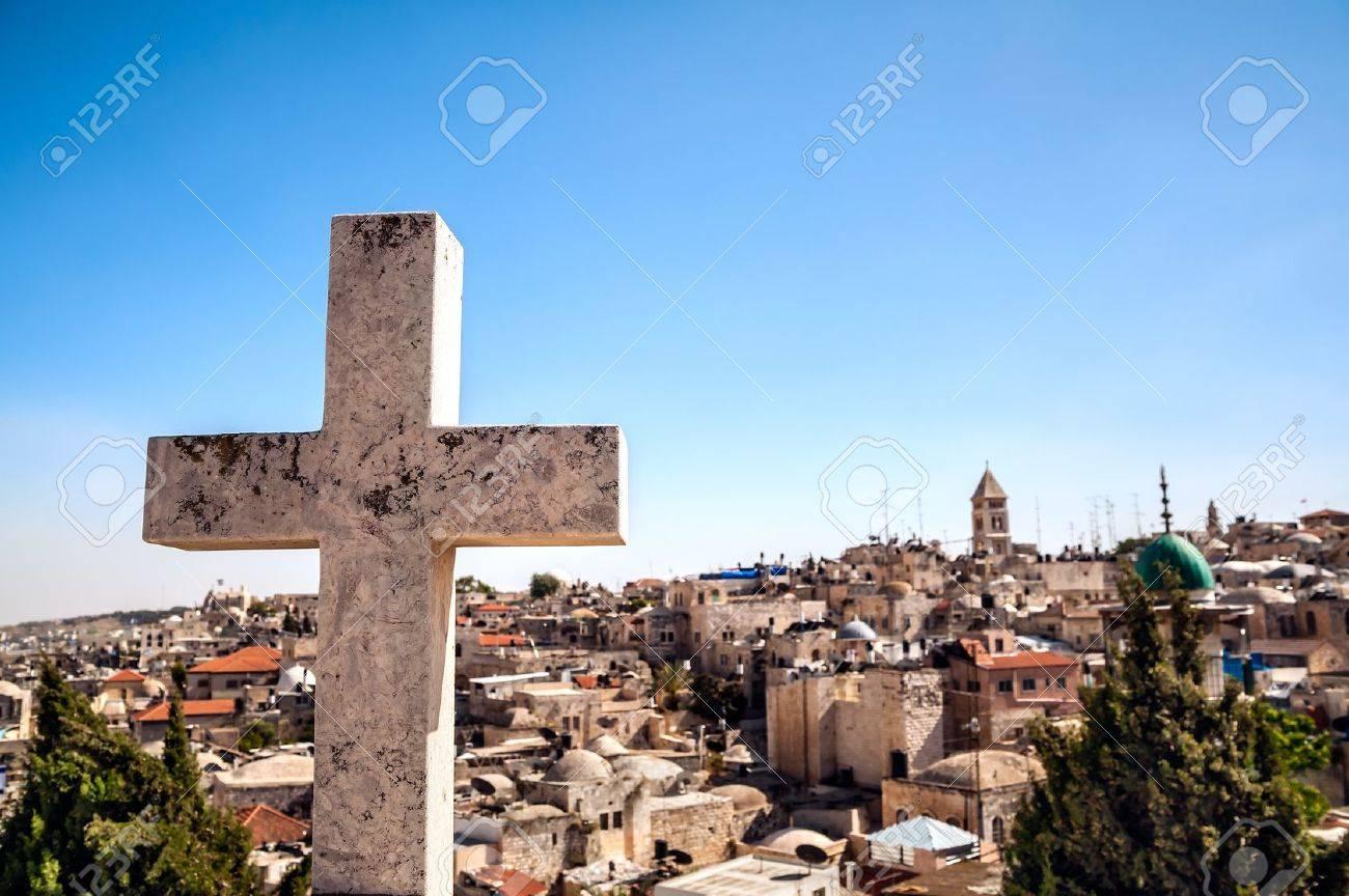 The cross on the background of Jerusalem Old City Stock Photo - 21325285