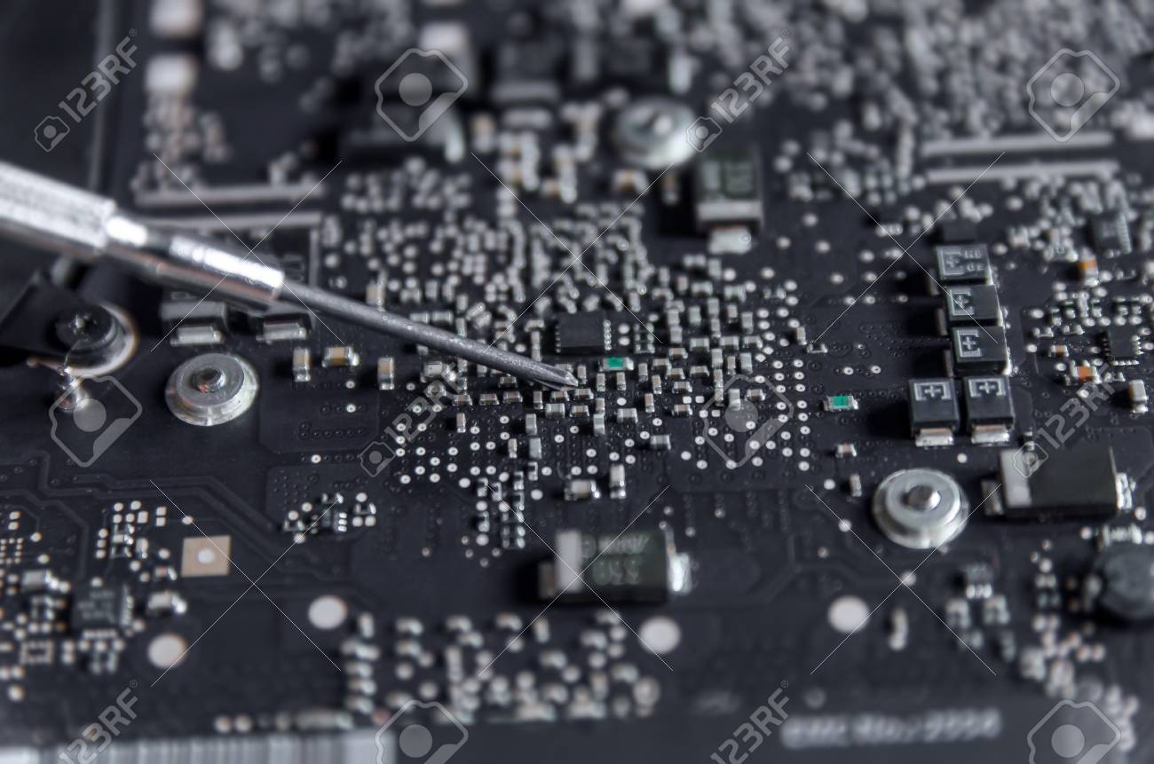 Close-up of circuit board and electronic computer hardware, Repairing