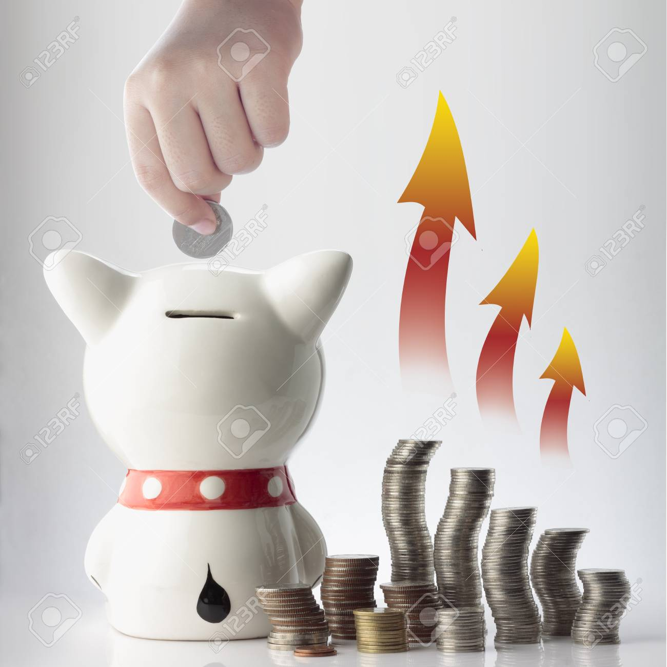 a hand saving coin in piggy bank with graphic on white background Stock Photo - 16163478