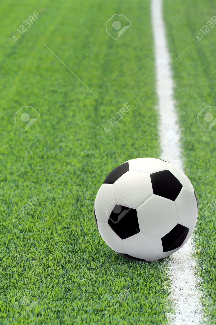 Soccer ball in the field Stock Photo - 12042656