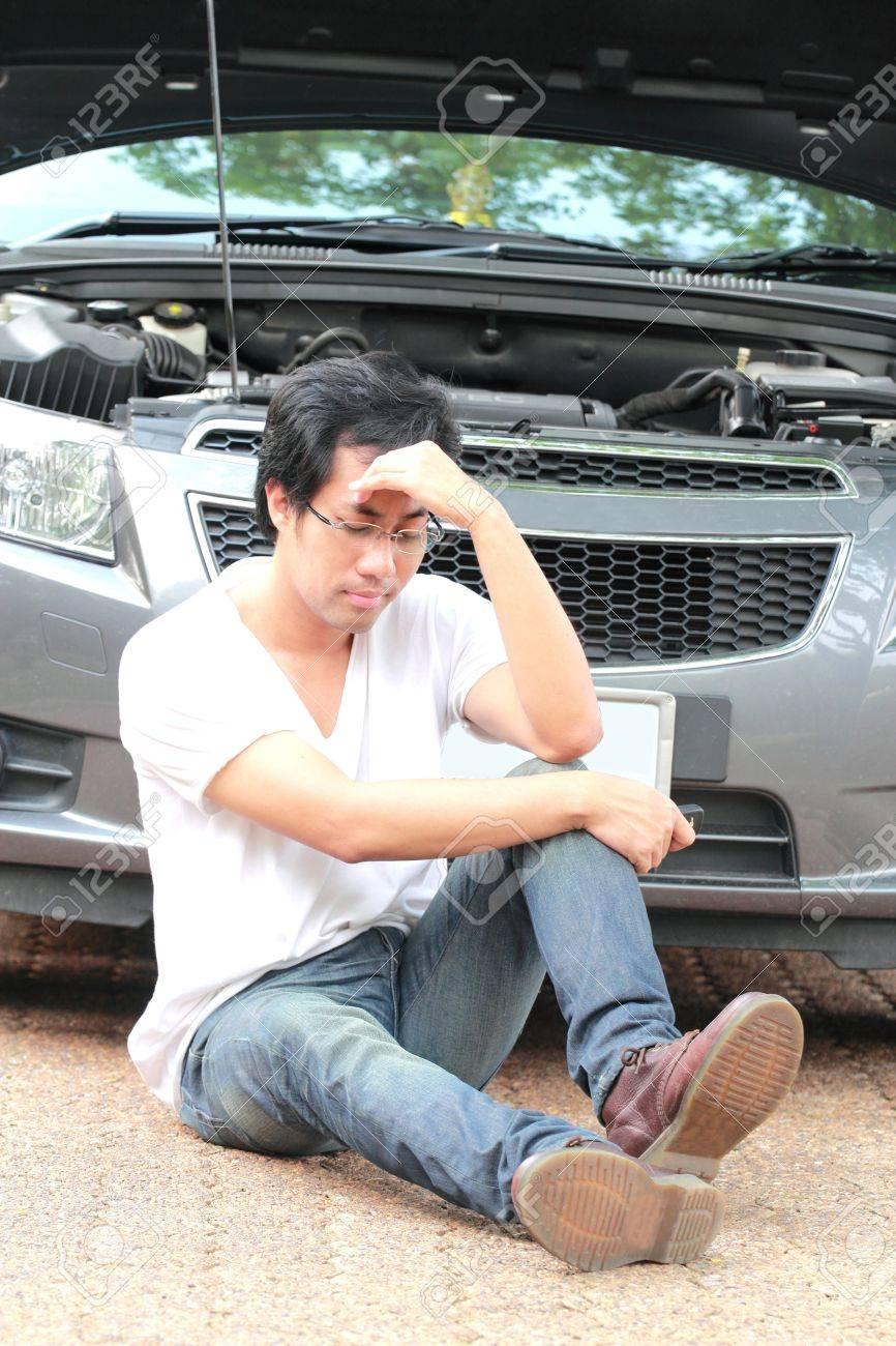 Dismal man when car breakdown Stock Photo - 12782783