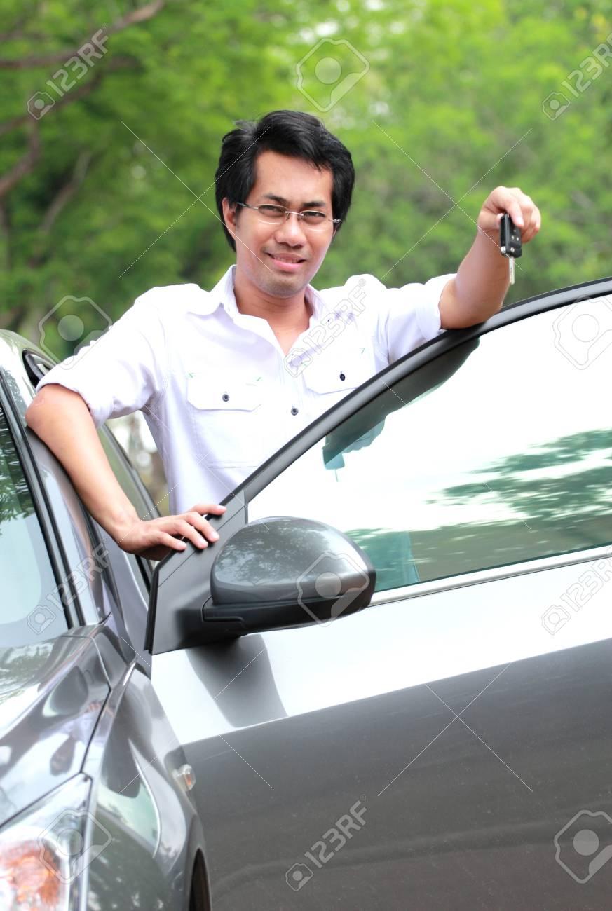 Man show the key Stock Photo - 12782776