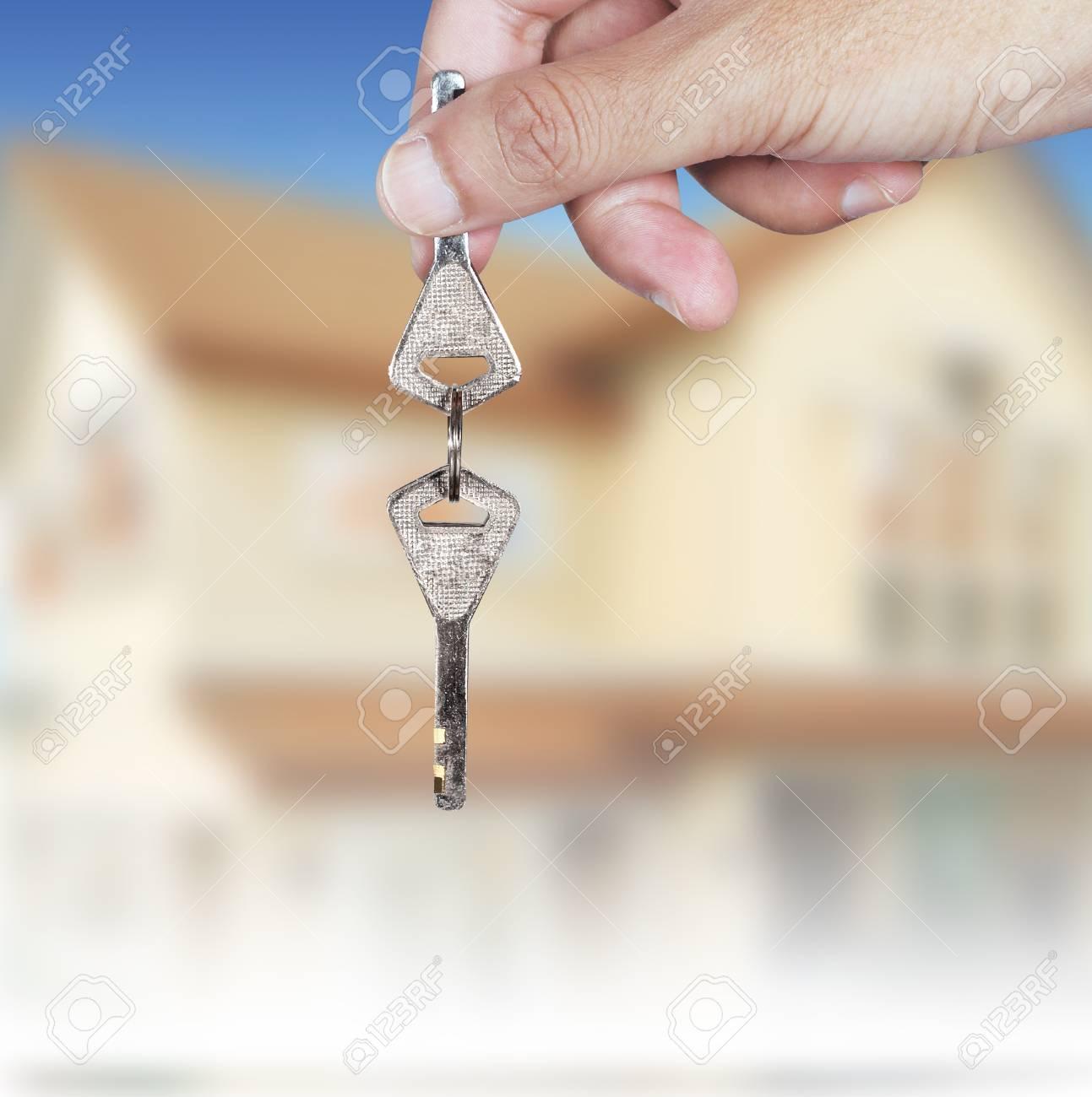 hand holding keys, house background Stock Photo - 14191153