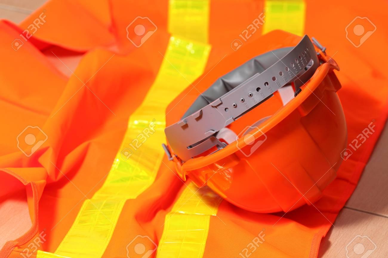 Protection helmet and orange vest Stock Photo - 14753913