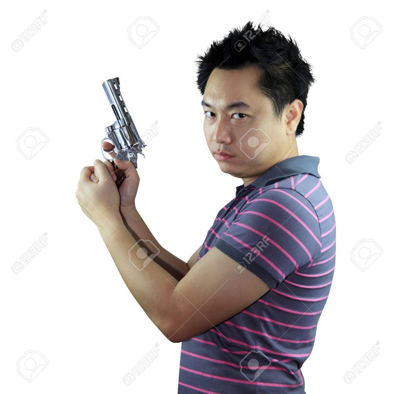 Man holding gun on white background Stock Photo - 17381281
