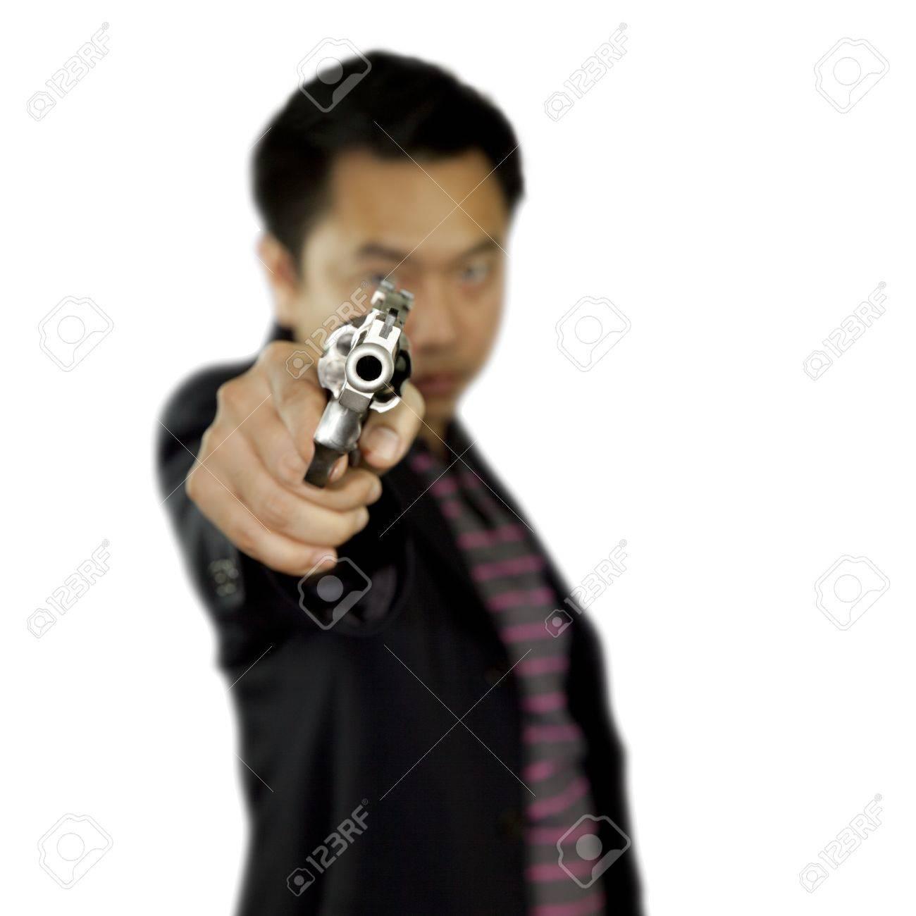 Man pointing gun on white background Stock Photo - 17381260