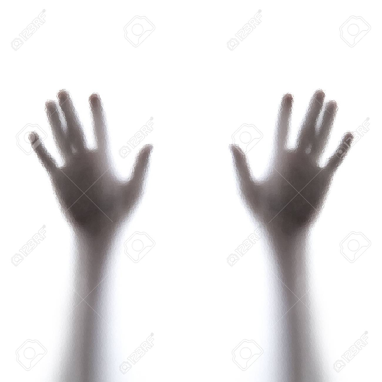 Shadow hands of the Man behind frosted glass Stock Photo - 18587726